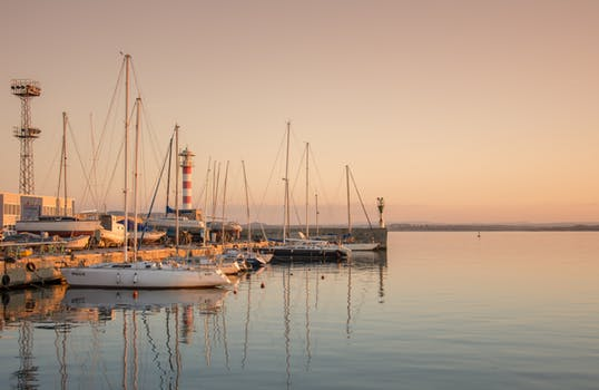Picturesque view of a dock with boats during a sunset.