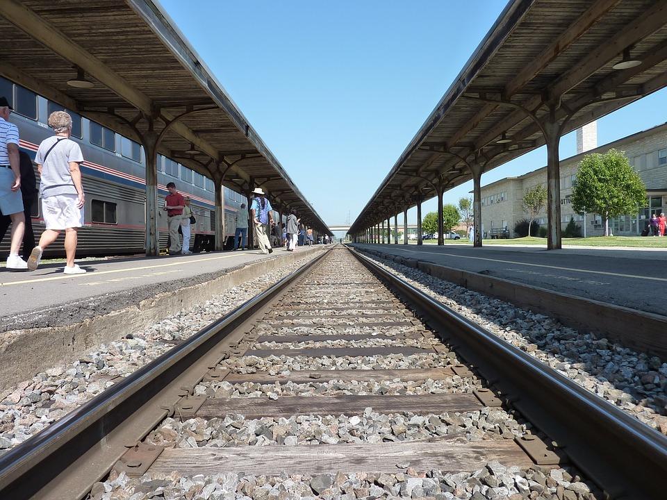 People walking along side train tracks
